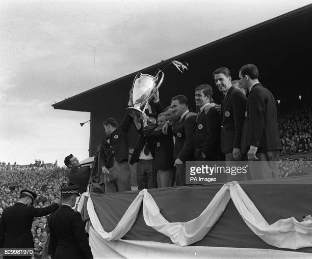 Celtic FC team and players at Celtic Park in Glasgow Scotland hold aloft and parade the European Cup in front of all their fans and supporters which...