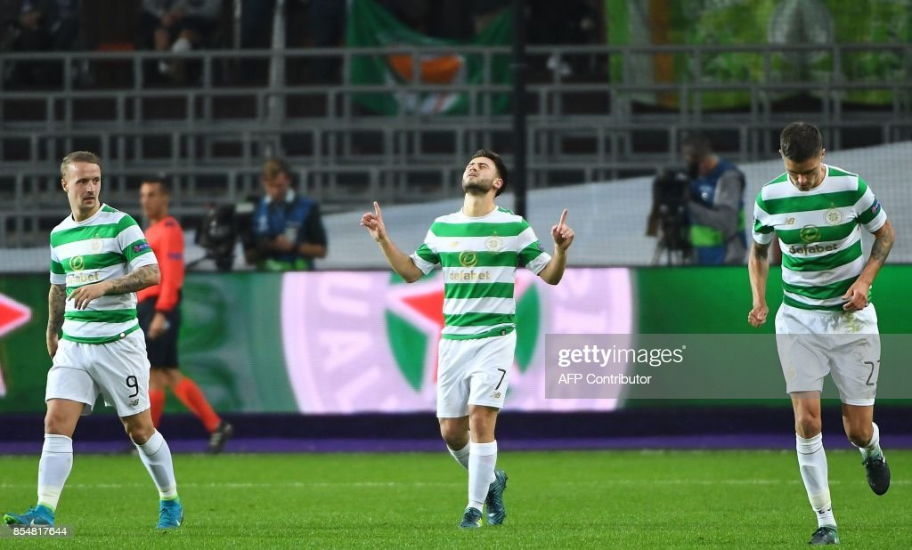 Celtic FC's Patrick Roberts (C) celebrates with teammates after scoring his team's second goal during the UEFA Champions League Group B football match Anderlecht vs Celtic at The Constant Vanden Stock Stadium in Brussels on September 27, 2017. /