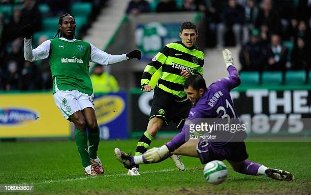 Celtic forward Gary Hooper scores the first Celtic goal during the Clydesdale Bank Premier League match between Hibernian and Celtic at Easter Road...