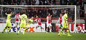 Celtic Glasgow's players react after scoring the 12 during the UEFA Europa League Group A football match Ajax Amsterdam vs Celtic Glasgow on...