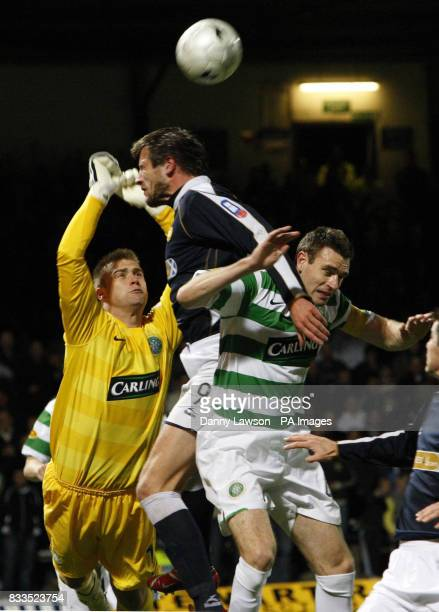Celtic goal keeper Artur Boruc Jan Zemlink and Celtic's Stephen McManus battle for the ball during the CIS Insurance Cup third round match at Dens...