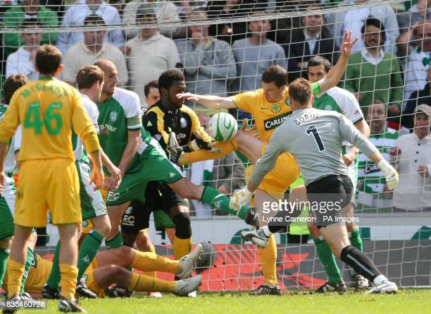 Celtic goalkeeper Artur Boruc and teammate Gary Caldwell are denied by Hibernian goalkeeper Yves MaKalambay as they push for a late winner during the...