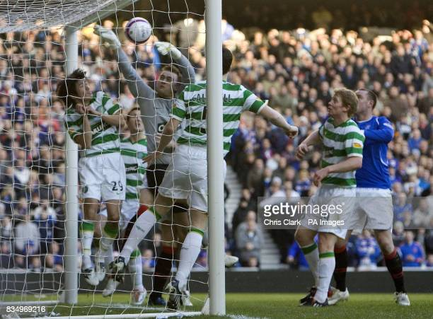 Celtic goalkeeper Artur Boruc fails to stop the ball going into his goal only for referee Craig Thomson to disallow itl due to a foul on the keeper...