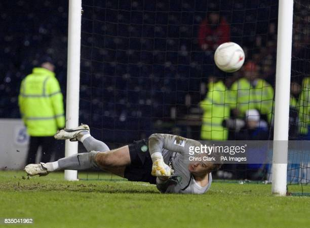 Celtic goalkeeper Artur Boruc saves a penalty during the shoot out following the Cooperative Insurance Cup Semi Final match at Hampden Park Glasgow
