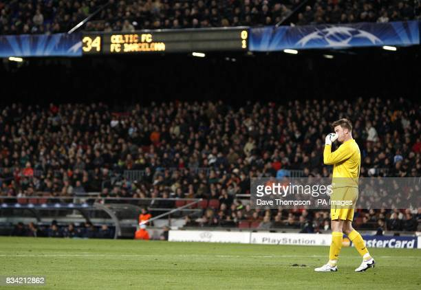 Celtic goalkeeper Artur Boruc stands dejected with the scoreboard in the background