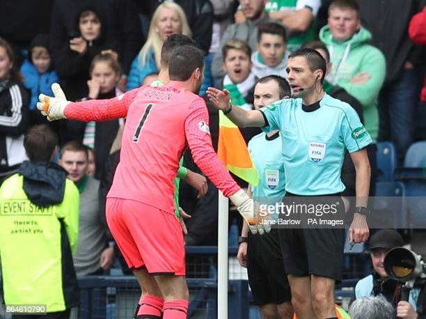 Celtic goalkeeper Craig Gordon appeals to the linesman after Hibs were awarded a penalty during the Betfred Cup semifinal match at Hampden Park...