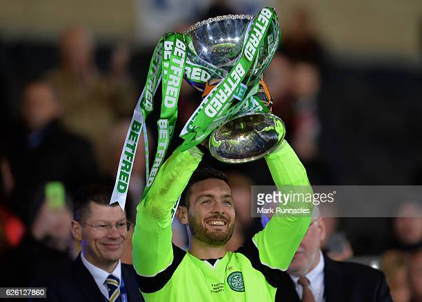 Celtic goalkeeper Craig Gordon lifts the trophy as Celtic win the Betfred Cup Final between Aberdeen FC and Celtic FC at Hampden Park on November 27...