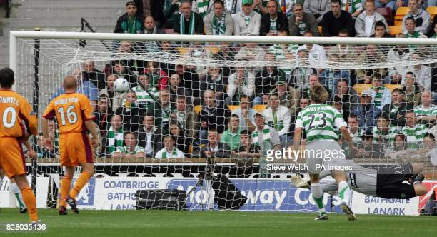 Celtic goalkeeper David Marshall can't stop Motherwell's Brian Kerr from scoring