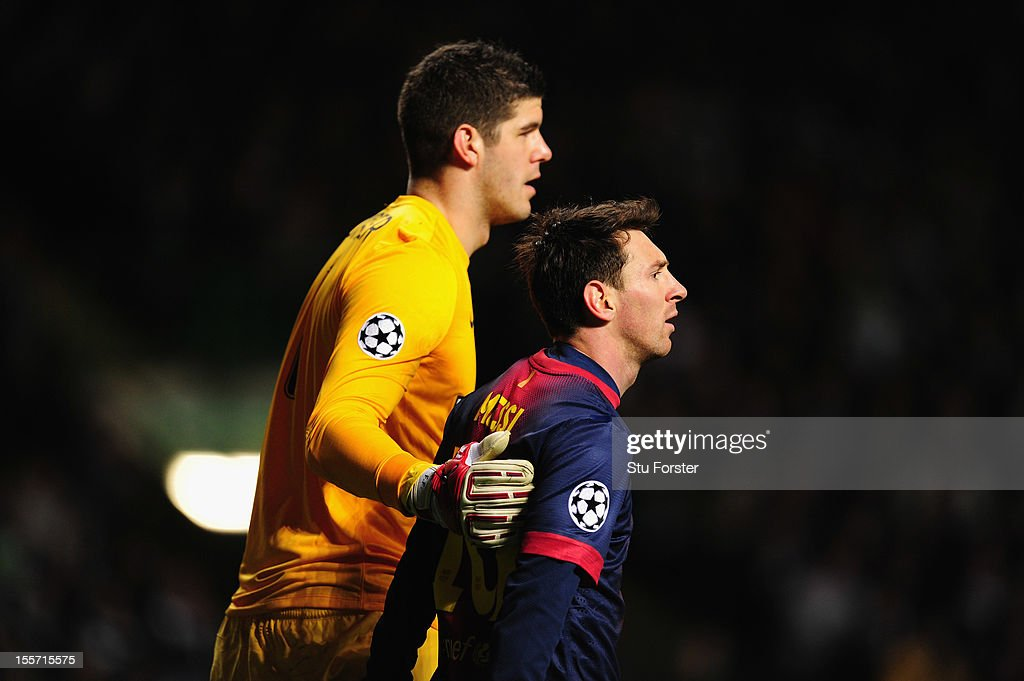 Celtic goalkeeper Fraser Forster (l) consoles Barcelona player Lionel Messi after a near miss during the UEFA Champions League Group G match between Celtic and Barcelona at Celtic Park on November 7, 2012 in Glasgow, Scotland.