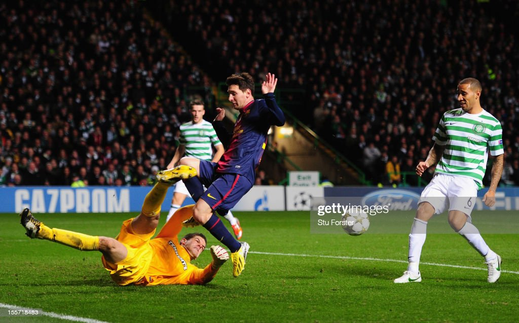 Celtic goalkeeper Fraser Forster denys Barcelona player Lionel Messi during the UEFA Champions League Group G match between Celtic and Barcelona at Celtic Park on November 7, 2012 in Glasgow, Scotland.
