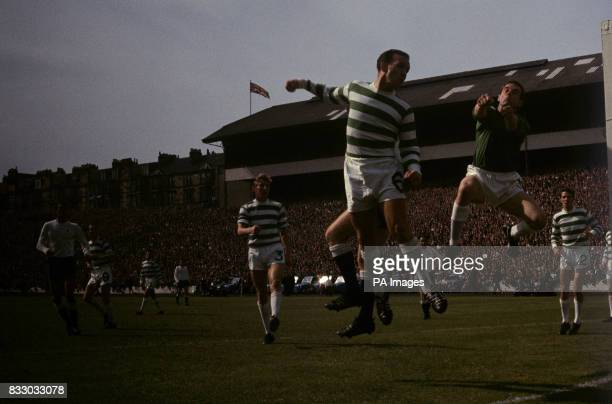 Celtic goalkeeper Ronnie Simpson punches clear from a Spurs corner With him is teammate John Clark The preseason challenge match at Hampden Park...