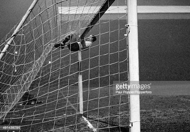 Celtic goalkeeper Ronnie Simpson swings from the cross bar as he celebrates their victory in the European Cup QuarterFinal 2nd leg match against...