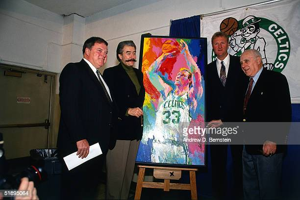 Celtic great Larry Bird poses with artist Leroy Nieman and his painting of Larry Bird in action and General Manager of the Boston Celtics Red...