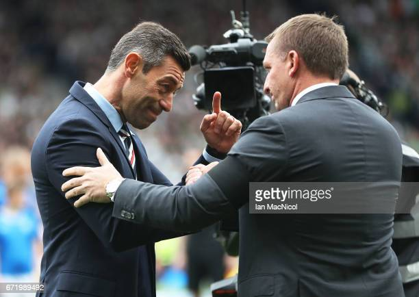 Celtic Manager Brendan Rodgers and Rangers manager Pedro Caixinha are seen during the William Hill Scottish Cup semifinal match between Celtic and...