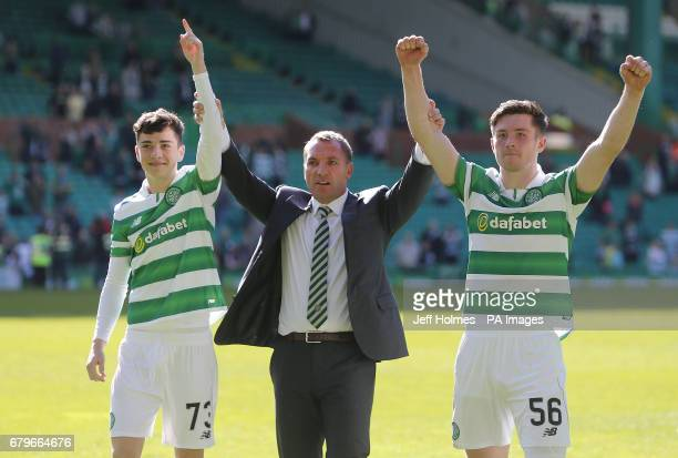 Celtic manager Brendan Rodgers with Michael Johnston and Anthony Ralston after the Scottish Premiership match at Celtic Park Glasgow