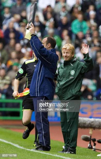 Celtic manager Gordon Strachan acknowledges the fans as they chant his name during the Clydesdale Bank Scottish Premier League match at Celtic Park...