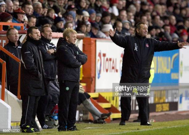 Celtic manager Gordon Strachan watches as Aberdeen manager Jimmy Calderwood signals to his team during the Clydesdale Bank Scottish Premier League...