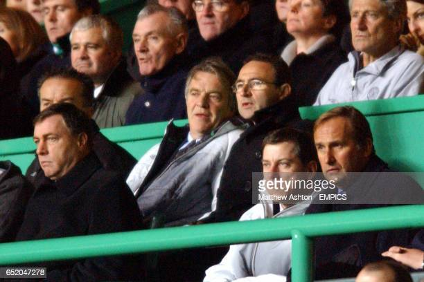 Celtic manager Martin O'Neill and his assistant John Robertson watch the game from the stands