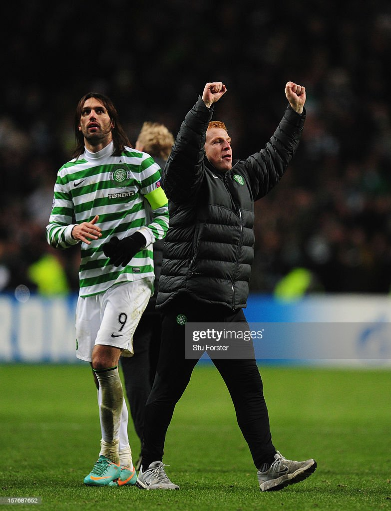 Celtic manager <a gi-track='captionPersonalityLinkClicked' href=/galleries/search?phrase=Neil+Lennon&family=editorial&specificpeople=642944 ng-click='$event.stopPropagation()'>Neil Lennon</a> (r) celebrates on the final whistle during the UEFA Champions League Group G match between Celtic FC and FC Spartak Moscow at Celtic Park on December 5, 2012 in Glasgow, Scotland.