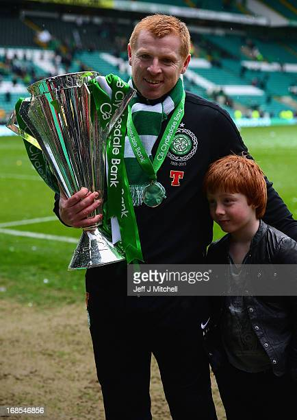 Celtic Manager Neil Lennon poses with the Scottish Premier League trophy and his son following the Clydesdale Bank Scottish Premier League match...