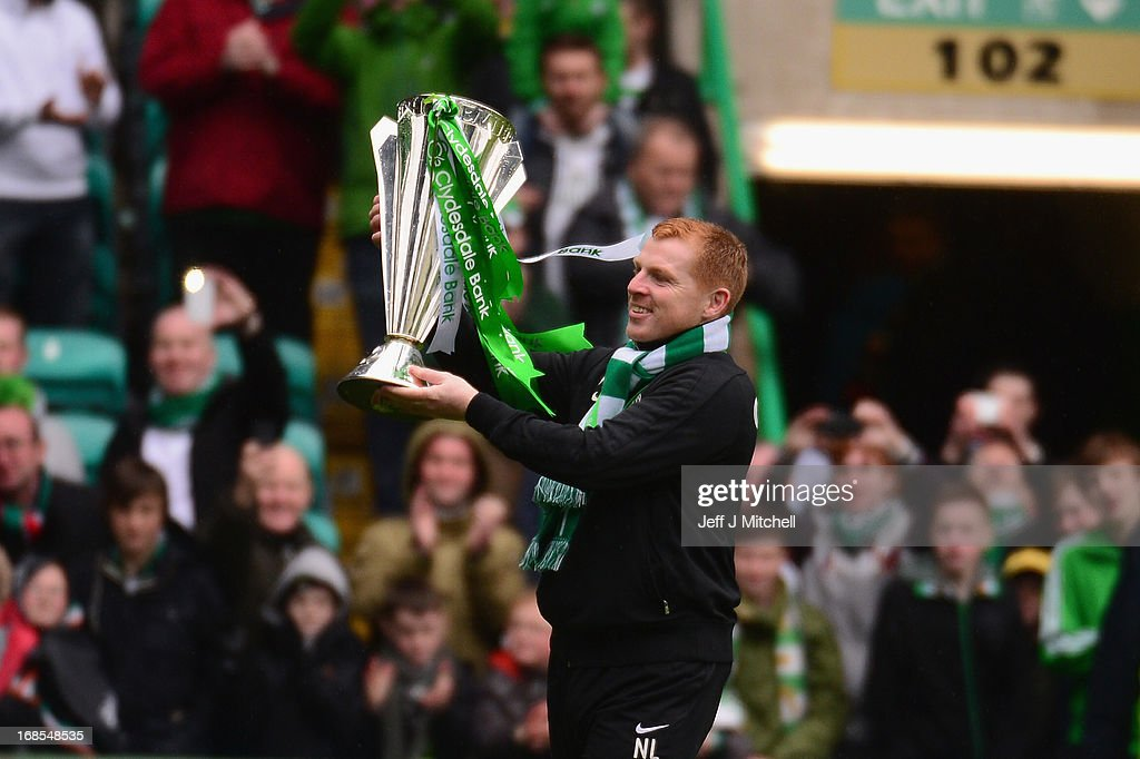 Celtic Manager Neil Lennon poses with the Scottish Premier League trophy following the Clydesdale Bank Scottish Premier League match between Celtic...