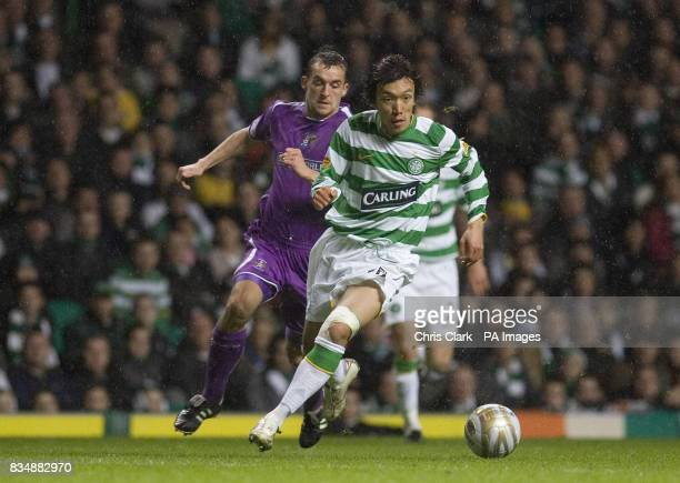 Celtic midfielder Shunzuke Nakamura breaks away from Kilmarnock defender James Fowler during the Clydesdale Bank Premier League match at Celtic Park...