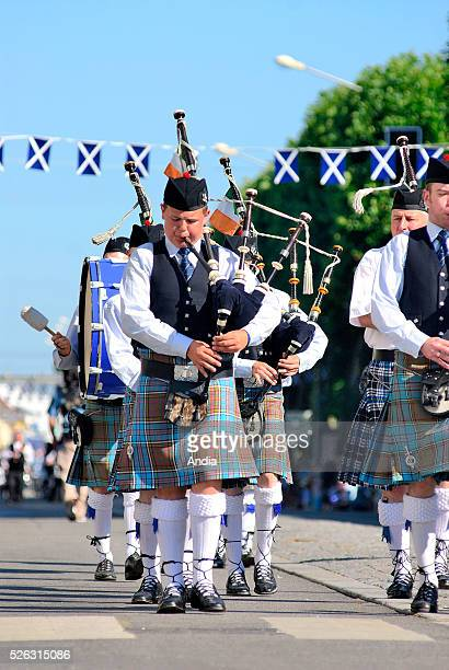 Celtic music performed by the Irish New Ross Pipe Band during the Grand Parade of Celtic Nations of the 'Festival Interceltique de Lorient' Musicians...