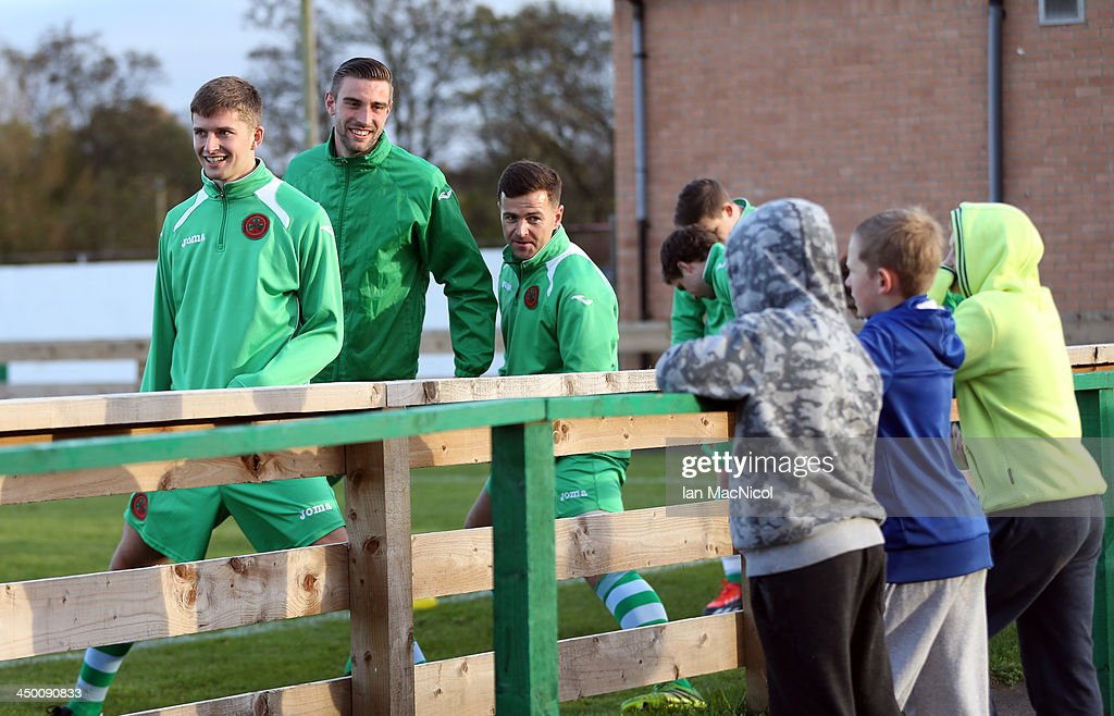 CARLISLE, ENGLAND - NOVEMBER 16 Celtic Nation players chat with fans as they warm up during the Ebac Division One football match between Celtic Nation and Hebburn Town on November 16, 2013 at Gillford Park in Carlisle, England.