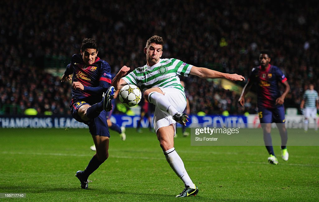 Celtic player Charlie Mulgrew (r) is denied a shot on goal by Barcelona player Marc Barta during the UEFA Champions League Group G match between Celtic and Barcelona at Celtic Park on November 7, 2012 in Glasgow, Scotland.