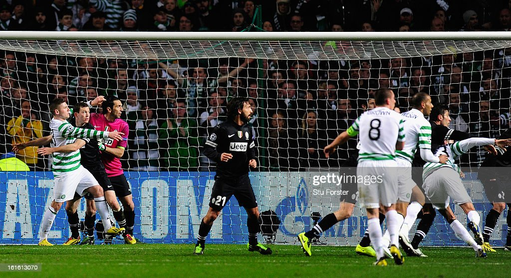 Celtic player Gary Hooper (l) is restricted in his movements by the Juventus defence during the UEFA Champions League Round of 16 first leg match between Celtic and Juventus at Celtic Park Stadium on February 12, 2013 in Glasgow, Scotland.