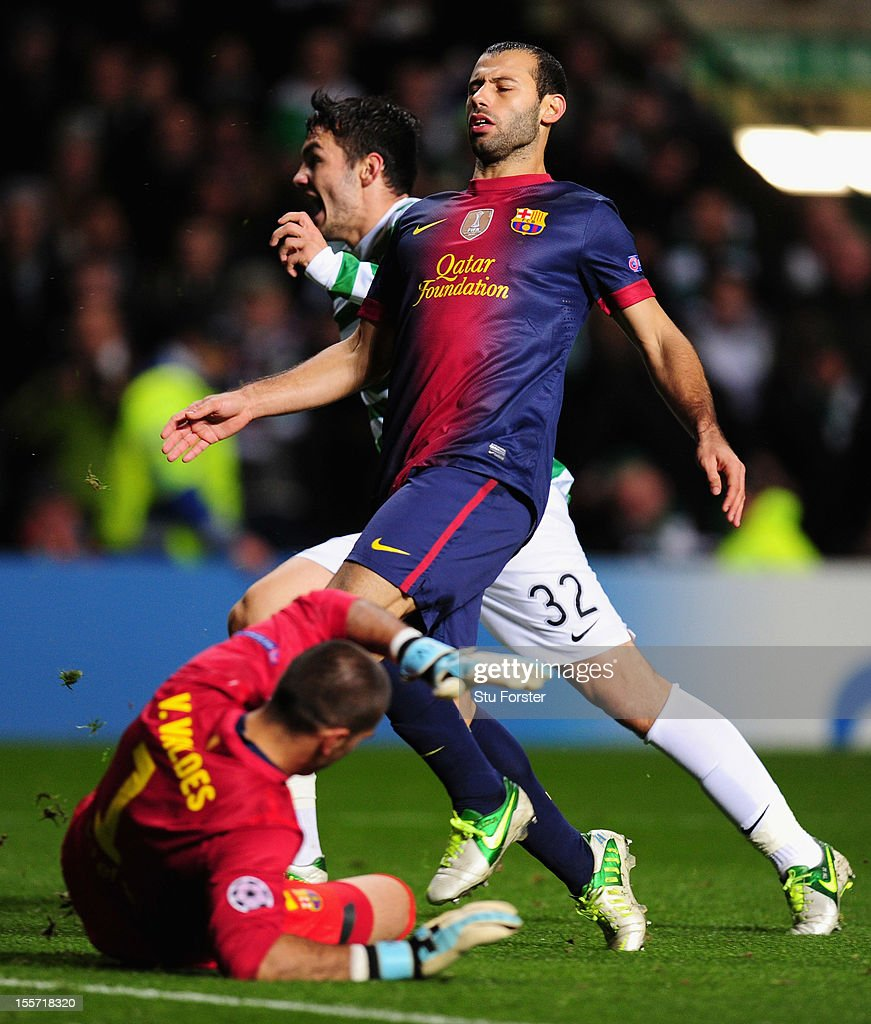 Celtic player Tony Watt (l) celebrates after scoring the second goal watched by Barcelona player <a gi-track='captionPersonalityLinkClicked' href=/galleries/search?phrase=Javier+Mascherano&family=editorial&specificpeople=490876 ng-click='$event.stopPropagation()'>Javier Mascherano</a> during the UEFA Champions League Group G match between Celtic and Barcelona at Celtic Park on November 7, 2012 in Glasgow, Scotland.