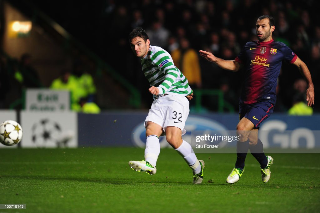 Celtic player Tony Watt (l) scores the second goal watched by Barcelona player Javier Mascherano during the UEFA Champions League Group G match between Celtic and Barcelona at Celtic Park on November 7, 2012 in Glasgow, Scotland.