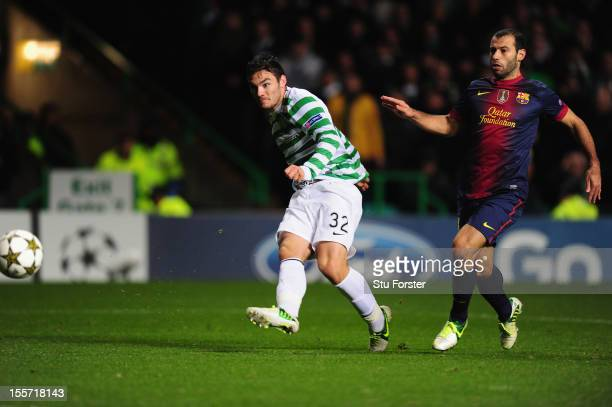 Celtic player Tony Watt scores the second goal watched by Barcelona player Javier Mascherano during the UEFA Champions League Group G match between...