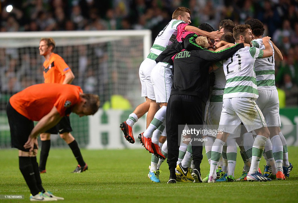 Celtic players and coaching staff celebrate victory after the UEFA Champions League Play Off Round Second Leg match between Celtic and FC Shakhter Karagandy at Celtic Park Stadium on August 28, 2013 in Glasgow, Scotland.