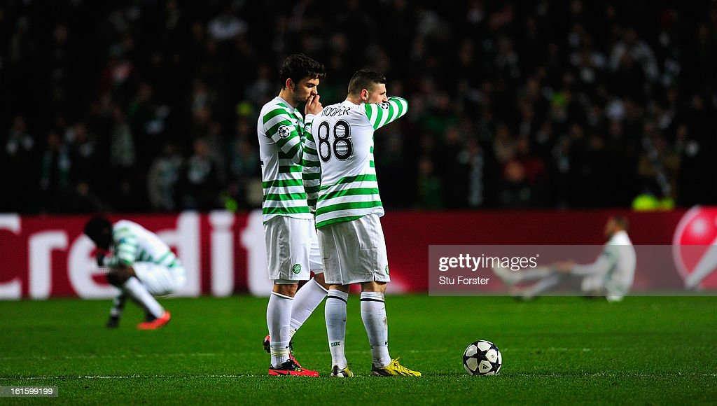 Celtic players Anthony Watt (l) and Gary Hooper look on dejectedly after the third Juventus goal during the UEFA Champions League Round of 16 first leg match between Celtic and Juventus at Celtic Park Stadium on February 12, 2013 in Glasgow, Scotland.
