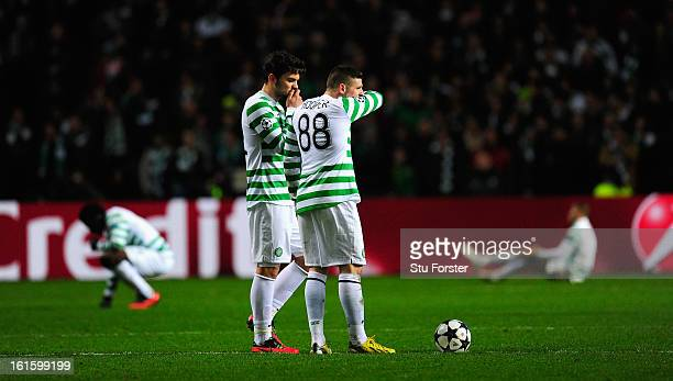 Celtic players Anthony Watt and Gary Hooper look on dejectedly after the third Juventus goal during the UEFA Champions League Round of 16 first leg...