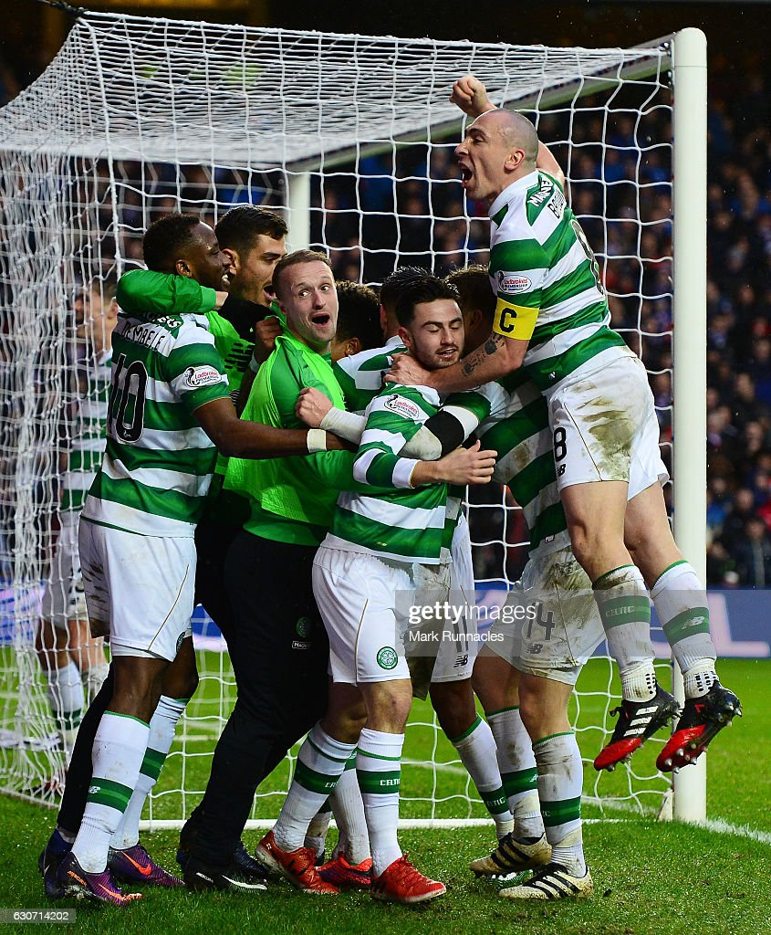 Celtic players celebrate their team's second goal scored by Scott Sinclair during the Ladbrokes Scottish Premiership match between Rangers and Celtic at Ibrox Stadium on December 31, 2016 in Glasgow, Scotland.