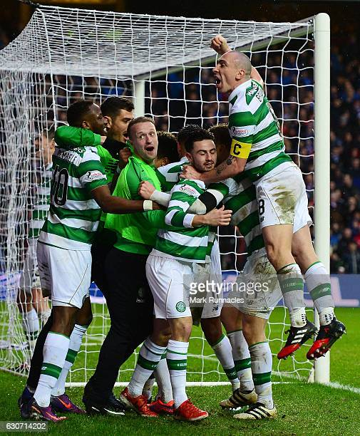 Celtic players celebrate their team's second goal scored by Scott Sinclair during the Ladbrokes Scottish Premiership match between Rangers and Celtic...