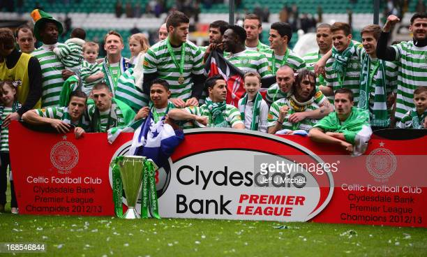 Celtic players celebrate with the Scottish Premier League trophy following the Clydesdale Bank Scottish Premier League match between Celtic and St...