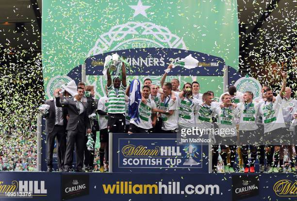 Celtic players celebrate with the trophy after defeating Hibernian 30 in their William Hill Scottish Cup Final match at Hampden Stadium on May 26...