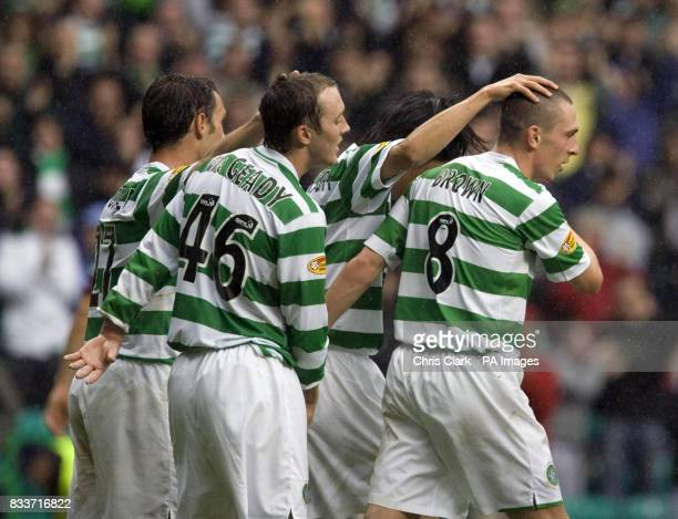 Celtic players crowd round Scott Brown after his goal against Heart's during the Clydesdale Bank Scottish Premier League match at Celtic Park Glasgow