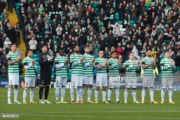 Celtic players join in a minutes applause in memory of former Celtic player Sean Fallon during the Clydesdale Bank Scottish Premier League match at...