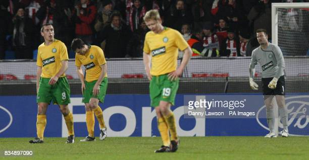 Celtic players Scott Brown Gary Caldwell Barry Robson and Artur Boruc react to Gary Caldwell's own goal during the UEFA Champions League match at the...