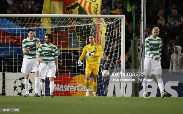 Celtic players stand dejected after Barcelona's Hernandez Xavi scores his sides first goal of the game