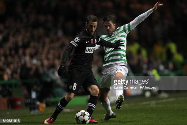 Celtic 's Mikael Lustig and Juventus' Claudio Marchisio battle for the ball