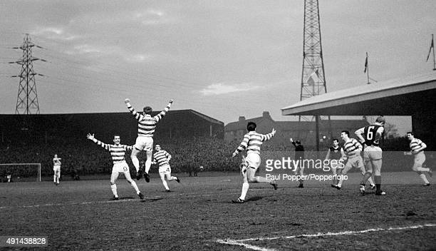 Celtic winger Jimmy Johnstone celebrates with his teammates after scoring their first goal against Dukla Prague during the European Cup SemiFinal 1st...