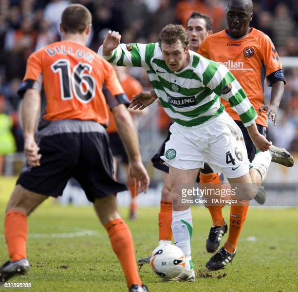 Celtic's Aiden McGeady tries to break through the tackle from Dundee's Morgaro Gomis during the Bank of Scotland Premier Division match at Tannadice...