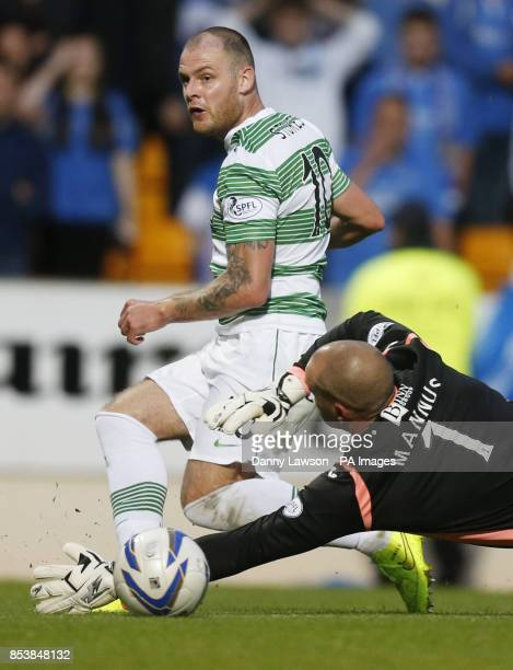 CROP* Celtic's Anthony Stokes scores with St Johnstone's Alan Mannus during the Scottish Premier League match at McDiarmid Park Perth