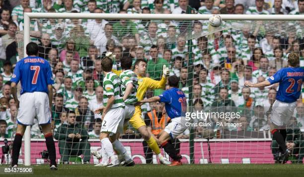 Celtic's Artur Boruc can only watch as a shot by Rangers' Daniel Cousin heads into the goal during the Clydesdale Bank Premier League match at Celtic...
