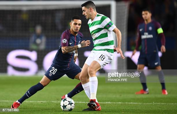 Celtic's Australian midfielder Tom Rogic controls the ball in front of Paris SaintGermain's French defender Layvin Kurzawa during the UEFA Champions...
